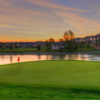 A sunset view of a green at Heritage Eagle Bend Golf Club.