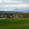 A view of a hole with mountains covered by snow in the distance at Walsenburg Golf Course.