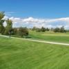 A sunny day view of a green at The Course from Petteys Park.