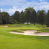 A view of a green protected by tricky bunkers at Columbine Country Club.